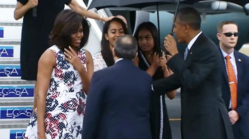 President Obama, First Lady Michelle and daughters Malia and Sasha arriving in Havana.