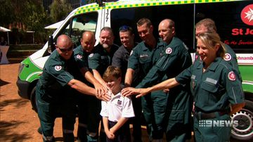 'He's suffocating under there': Paramedic honoured for saving boy