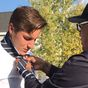 Cop teaches teen how to knot a tie for his homecoming in viral video