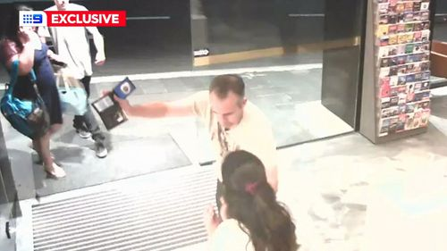 A new NSW police officer waves his badge while drunk on a night out.