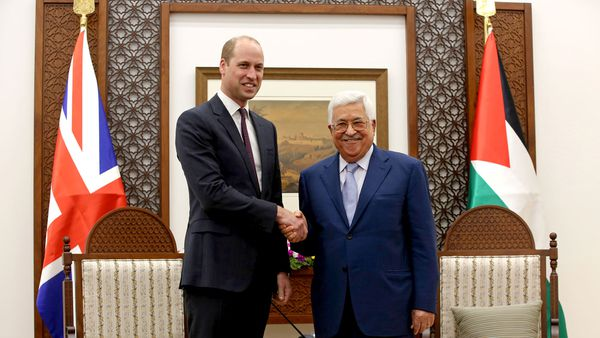 Prince William shakes hands with Palestinian President Mahmoud Abbas in the West Bank City of Ramallah. (AAP)
