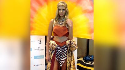 Miss Martin poses in a Dreamtime-inspired ensemble, by designer Caitlin Holstock, which was featured in the national costume portion of the Miss Universe international final. (AAP)