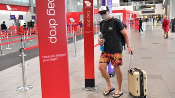 A passenger is seen at the Virgin Australia terminal at the Brisbane Domestic Airport in Brisbane, in March.