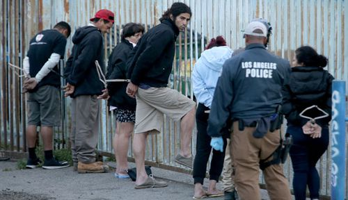 US police round up suspected MS-13 gang members in Los Angeles. (Photo: Getty).