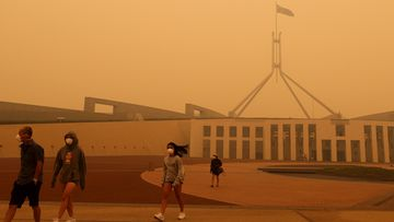 Visitors to Parliament House forced to wear face masks after smoke from bushfires blankets Canberra in a haze with hazardous air quality, on Sunday