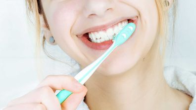 Close up of woman brushing teeth