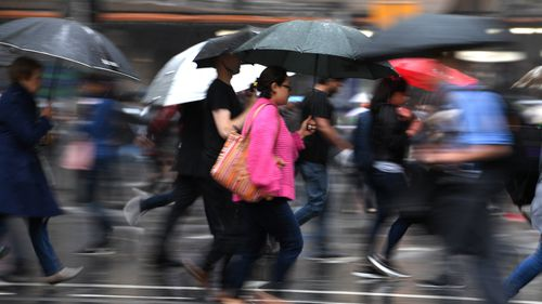 The umbrellas were out in the CBD today as Sydney copped a drenching. (AAP)
