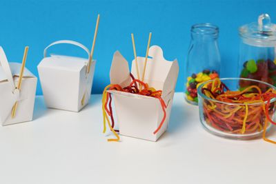 "<p>Oodles of Noodles Boxes</p> <p>Let your guests fill their own noodle box with noodle-like lollies like these <a href=""http://www.theprofessors.com.au/products/tnt-sour-strings-multicolour-240pc-display-unit.html"" target=""_blank"" draggable=""false"">multi-coloured sour strings</a>. Add <a href=""http://www.gyrofish.com.au/kidstix-kids-chopsticks?gclid=CL_u1P3YjNQCFcdWvQodQd8Ceg"" target=""_blank"">colourful chopsticks sets</a> for extra fun.</p>"