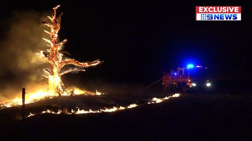 Many residents endured a sleepless night as the fires rapidly approached. (9NEWS)