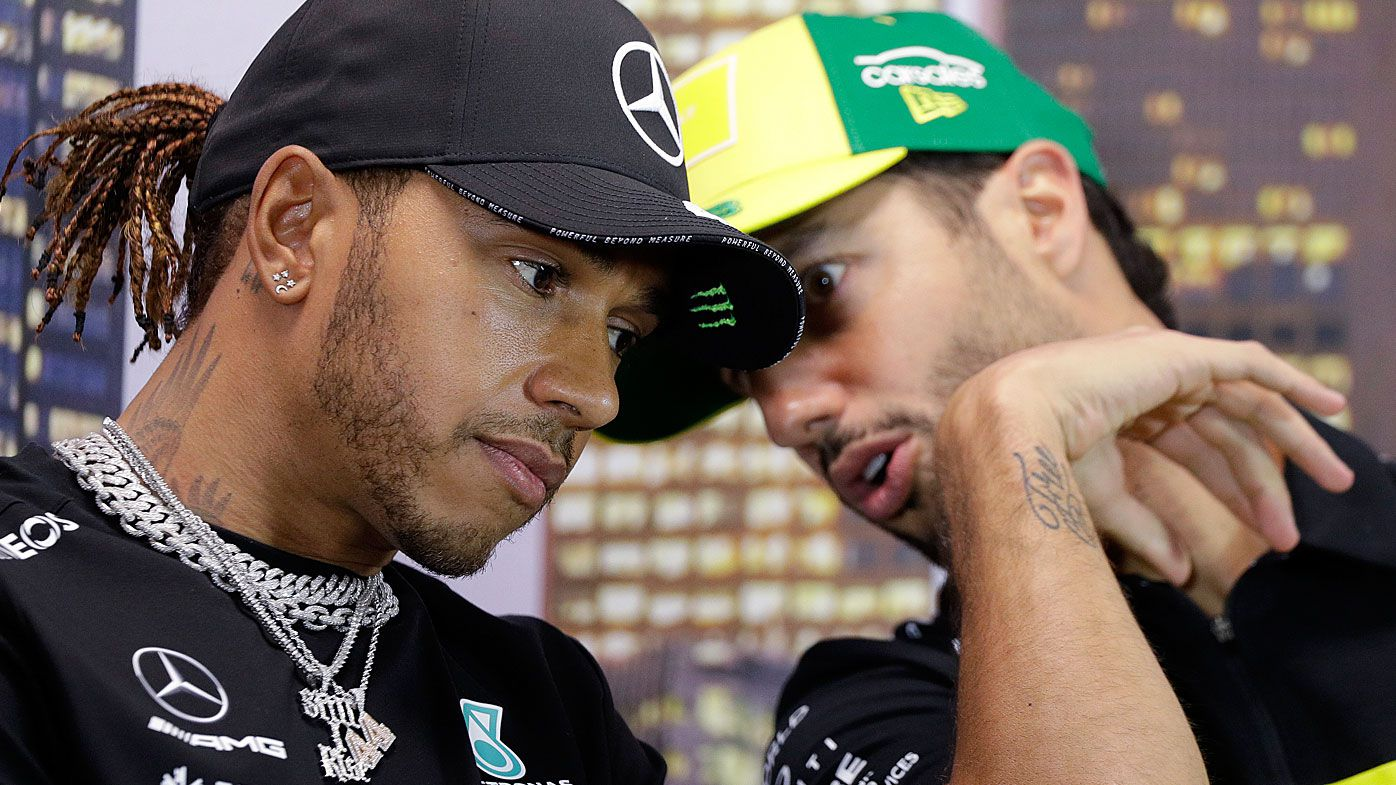 Mercedes driver Lewis Hamilton of Britain and Renault driver Daniel Ricciardo of Australia, right, talk during a press conference at the Australian Formula One Grand Prix