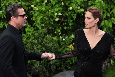 Brangelina brawl! We don't know what's going on here, but their faces are priceless.
