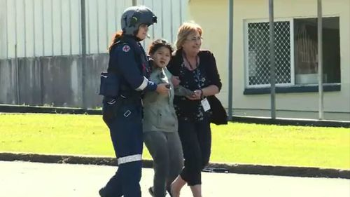 Joohee Han is assisted by emergency services personnel. Picture: 9NEWS