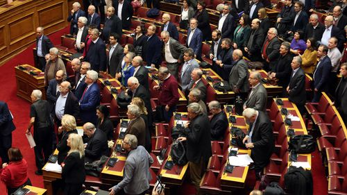 The deal passed with 153 votes in the 300-member parliament, two more than needed.