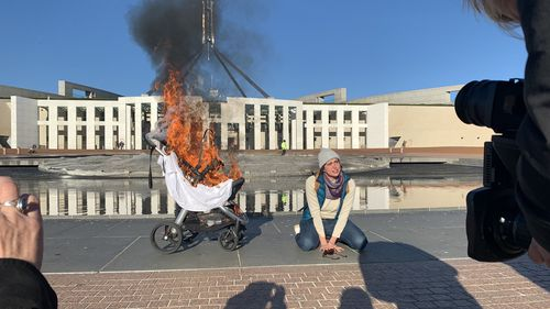 A climate protest has ramped up outside Parliament House following a climate change report.