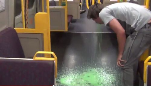 The vomit prank was one of several that saw Adrian Van Oyen banned from Queensland trains for life. (YouTube)