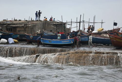 A fishing boat being to a safer ground on the Arabian Sea coast in Veraval, Gujarat, India. (AP Photo/Ajit Solanki)