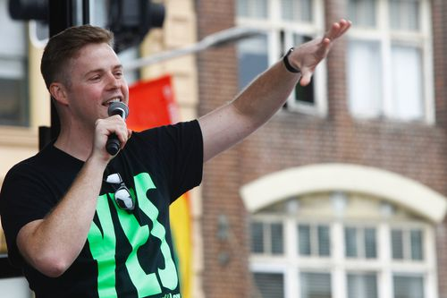 Comedian Tom Ballard performs at a street party in support of marriage equality in Darlinghurst, Sydney.