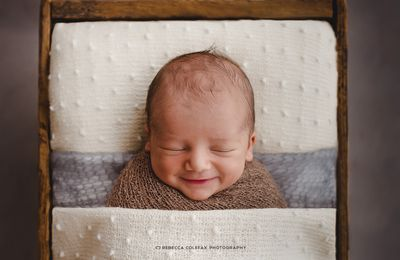 """<p>Newborn photographer <a href=""""www.rebeccacolefax.com"""" target=""""_blank"""" draggable=""""false"""">Rebecca Colefax</a> is not your average  shutterbug. The Queensland mother-of-three was once a  world champion kite surfer. But once she became a mother she gravitated towards baby photography. And she's bringing a fresh perspective to an industry traditionally known for its kitsch newborn set-ups of winged babies  in tiny wheelbarrows. Instead, Rebecca might zoom in on  the whorls of hair on a newborns' head or their chubby rolls of skin. Rebecca captures a unique feature or expression of every baby she photographs &mdash; and she's winning awards because of it. Scroll through and be inspired by Rebecca's memory-making moments ...</p> <p>&nbsp;</p>"""