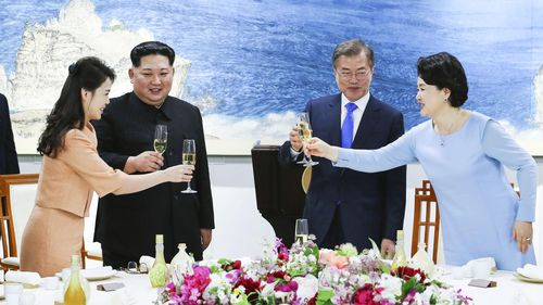 President Moon Jae-in and his wife Kim Jung Sook alongside Kim Jong-un and his wife Ri Sol Ju at a banquet at the House of Peace in the border village. (AAP)