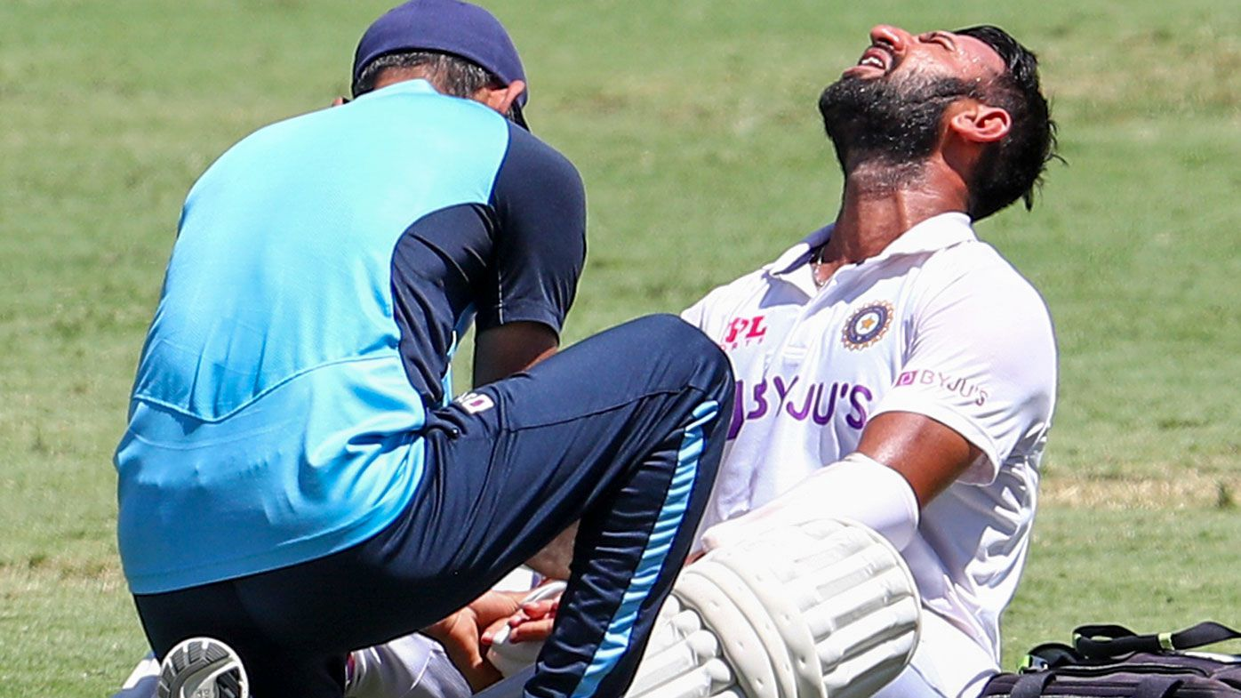 Cheteshwar Pujara receives treatment during his innings in the fourth Test.
