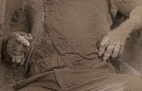 A victim of the volcano completely covered in ash. Picture: AAP