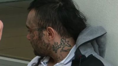 Man covered in face tattoos arrested after police dog pursuit