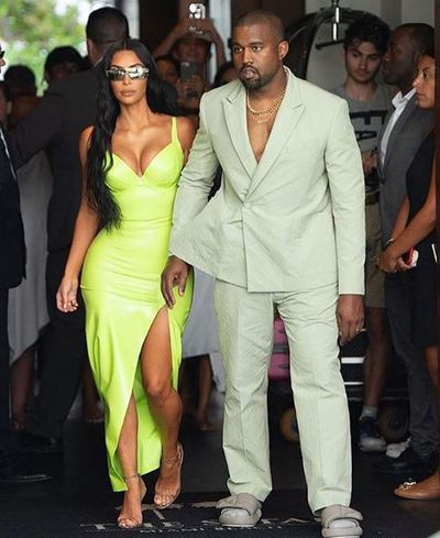 Kim Kardashian and husband Kanye West at a friend's wedding in Miami, August, 2018