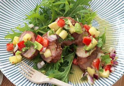 Pork salad with pineapple avocado salsa