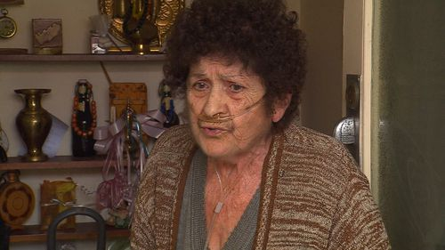 Three men wearing balaclavas smashed through a window of a 74-year-old's home, demanding money and injuring her arm. Picture: 9NEWS