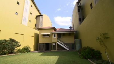 <p>A narrow West End property hemmed in by apartment blocks will go to auction next month, after its owners previously refused to sell to developers.</p><p><strong>Click through the gallery to see more images of the narrow home.</strong></p>