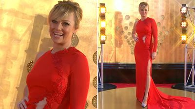 Television personality Shelley Craft wore a red Arthur Galan one-sleeved gown with cut-out detail.