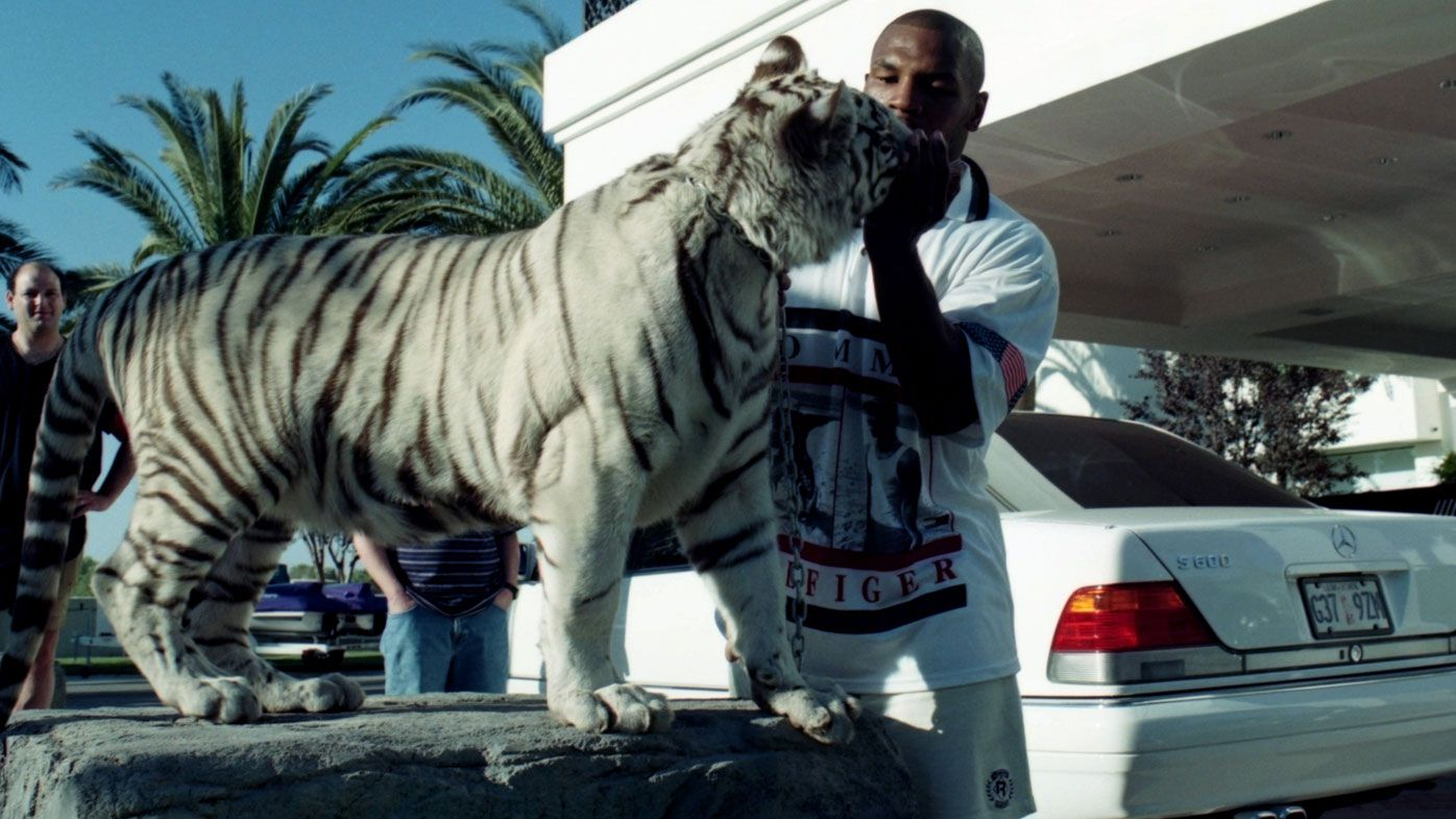 Mike Tyson paid a trespasser $US250,000 after his pet tiger 'ripped her arm off'