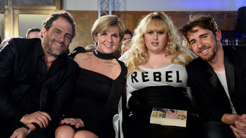 Australian Minister of Foreign Affairs Julie Bishop along with US director/producer Brett Ratner and Australian actors Rebel Wilson and Hugh Sheridan attend runway shows during Los Angeles Fashion Week at Union Station in Los Angeles in 2015. (AAP)