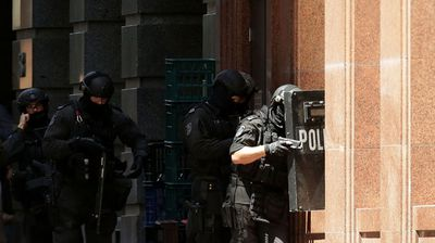 Armed policeman are seen outside Lindt Cafe on Philip St. (Getty)