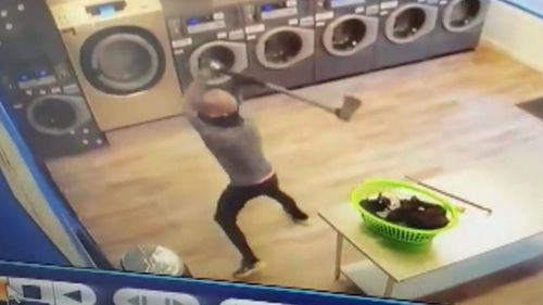 An axe-wielding thief has robbed an Adelaide laundromat.