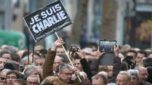 Thousands of people gather at Republique square in Paris, France. (AAP)