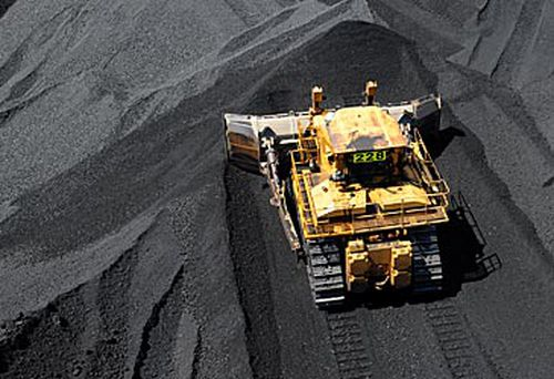 Bulldozer shifting coal (AAP)