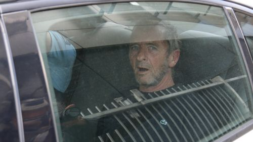 AC/DC drummer Phil Rudd appears in court after 'fighting with bodyguard'