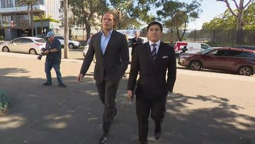 George Burgess outside court today with his lawyer Bryan Wrench.
