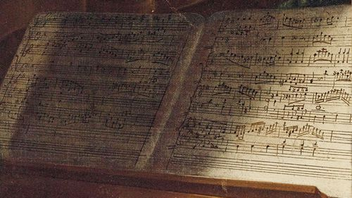 It is not known whether the score in front of Mozart was his own composition.