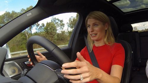 A Current Affair reporter Alison Piotrowski test-drives the driverless Volvo, with only light pressure on the wheel for legal reasons.