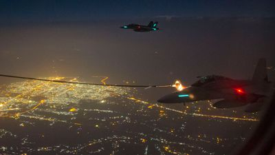 Two Royal Australian Air Force (RAAF) F/A-18F Super Hornets conduct air to air refuelling in Iraq. (AAP/Australian Department of Defence, Sergeant Hamish Paterson)