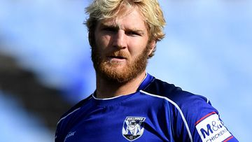 Aiden Tolman has been named as the Bulldogs player caught up in a COVID-19 scare.