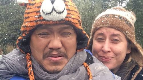 Taj Martin-Simpson, pictured with her fiance Saray So, when he experienced his first snow fall in Tasmania in 2016.