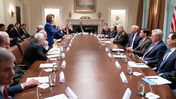 Speaker Nancy Pelosi and President Donald Trump speak to each other in a meeting at the White House.