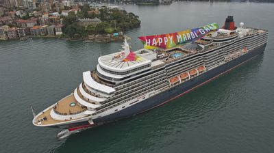 The luxury liner Queen Elizabeth gets on board with Mardi Gras celebrations (AAP)