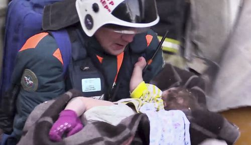 An 11-month-old boy who was found alive Tuesday nearly 36 hours after the collapse was in serious but stable condition at a children's hospital in Moscow.