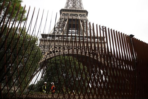 An unsightly metal fence was originally built around the Eiffel Tower. Image: AAP