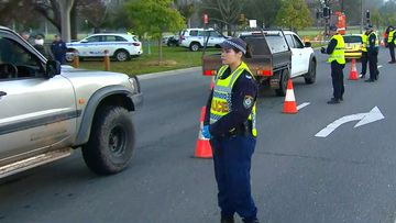 NSW Police stop vehicles and check for permits on the first day of travel, since the Victoria-NSW border was closed.