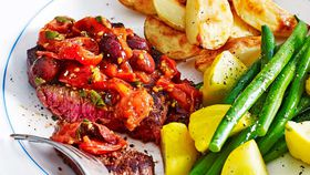 Steak with roast cherry tomato and olive sauce